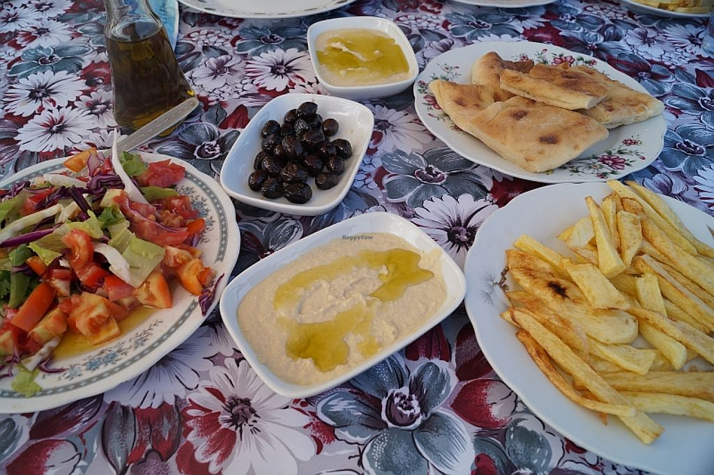 "Photo of Livana Bungalow Hotel  by <a href=""/members/profile/danielpoland"">danielpoland</a> <br/>Vegan Mezze with Hummus, olives and salad. All vegan <br/> August 16, 2015  - <a href='/contact/abuse/image/62034/113884'>Report</a>"