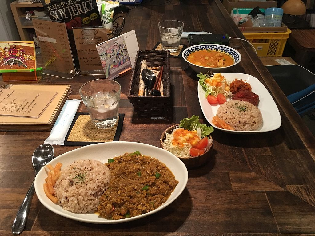 """Photo of VegReca  by <a href=""""/members/profile/a.s."""">a.s.</a> <br/>Keema curry, coconut curry, Wakame/Ume tea, sides: Vadai, some pickles or salad (I forgot since it wasn't my order...) I also got the soy-karage which where very good, but unfortionately didn't make it on the picture since they arrived a little later <br/> March 3, 2018  - <a href='/contact/abuse/image/62110/366200'>Report</a>"""