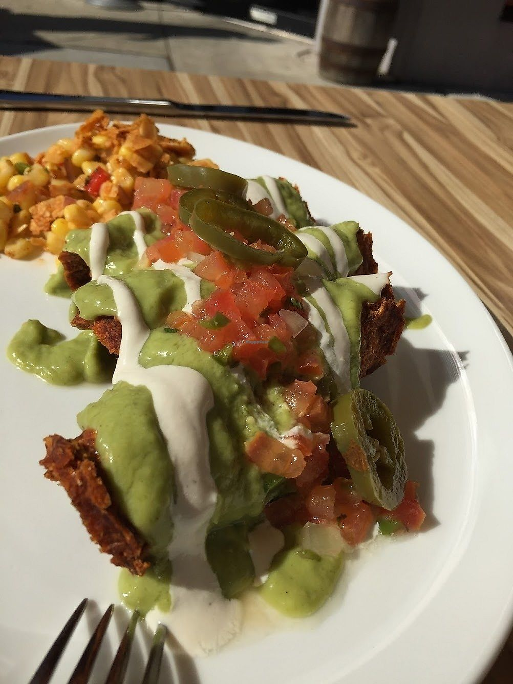 """Photo of The Cider Press Cafe   by <a href=""""/members/profile/Jamie9705"""">Jamie9705</a> <br/>Vegan enchiladas w/ a corn salad side  <br/> September 13, 2017  - <a href='/contact/abuse/image/62213/304011'>Report</a>"""