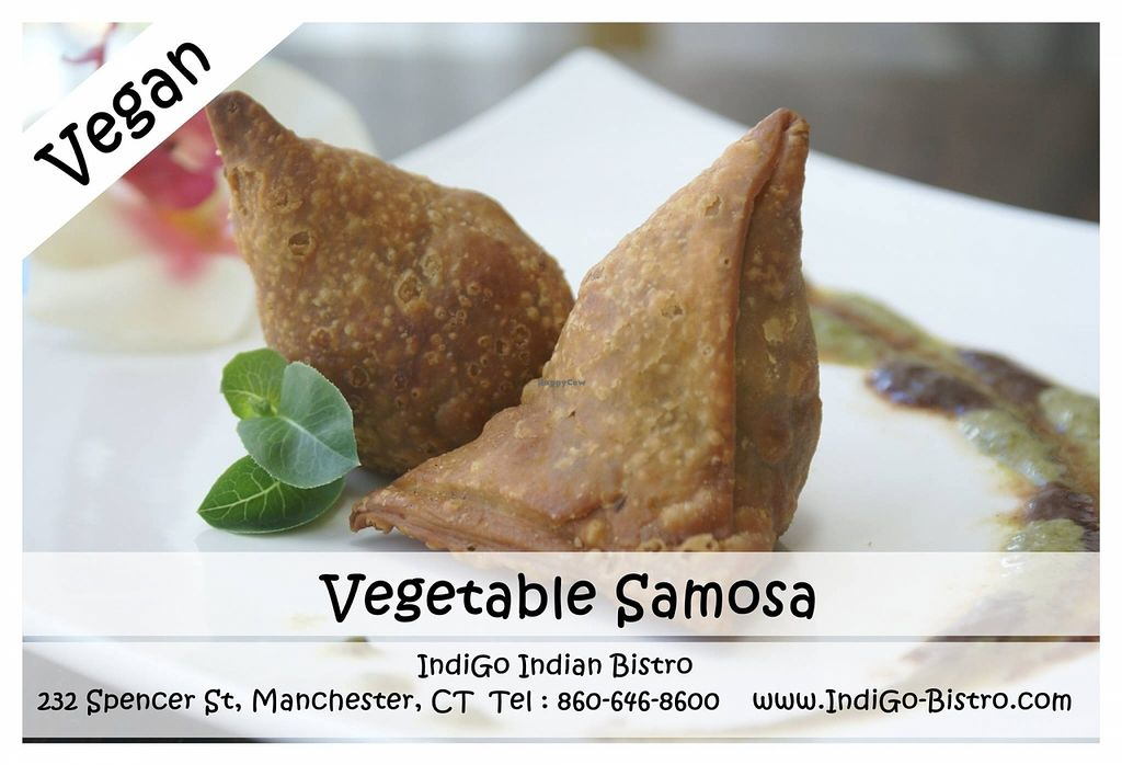 """Photo of IndiGo Indian Bistro  by <a href=""""/members/profile/IndiGoManchester"""">IndiGoManchester</a> <br/>Vegetable Samosa (Vegan) @ IndiGo Indian Bistro - Manchester CT Crispy pastry stuffed with spiced potato & green peas <br/> August 22, 2015  - <a href='/contact/abuse/image/62342/114683'>Report</a>"""