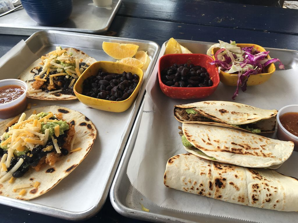 "Photo of La Botanica  by <a href=""/members/profile/cflores"">cflores</a> <br/>Sunday brunch: potato & bean tacos (left). Jackfruit barbacoa tacos w/ coleslaw  <br/> January 5, 2018  - <a href='/contact/abuse/image/62870/343292'>Report</a>"