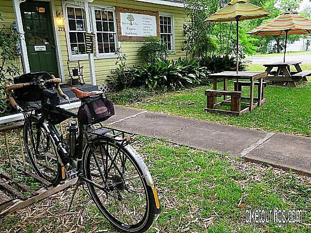 "Photo of Natural Living Food Co-op and Cafe  by <a href=""/members/profile/BikeTourings"">BikeTourings</a> <br/>At Natural Living Food Co-op and cafe where they've added additional outdoor seating area with another umbrella covered picnic table made from recycled pallet wood, so ficken cool <br/> June 30, 2017  - <a href='/contact/abuse/image/62948/275209'>Report</a>"