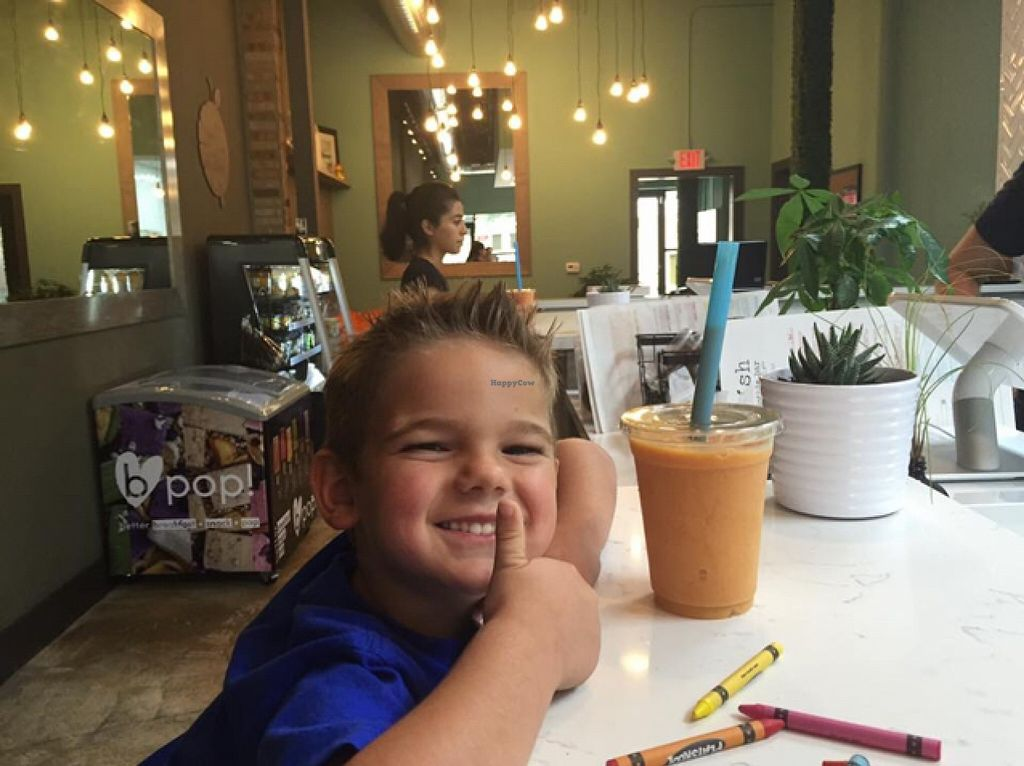 """Photo of Nourish Juice & Smoothie Bar  by <a href=""""/members/profile/JessicaGlobeTrotter"""">JessicaGlobeTrotter</a> <br/>Cullen and his smoothie!  <br/> September 5, 2015  - <a href='/contact/abuse/image/62987/116471'>Report</a>"""