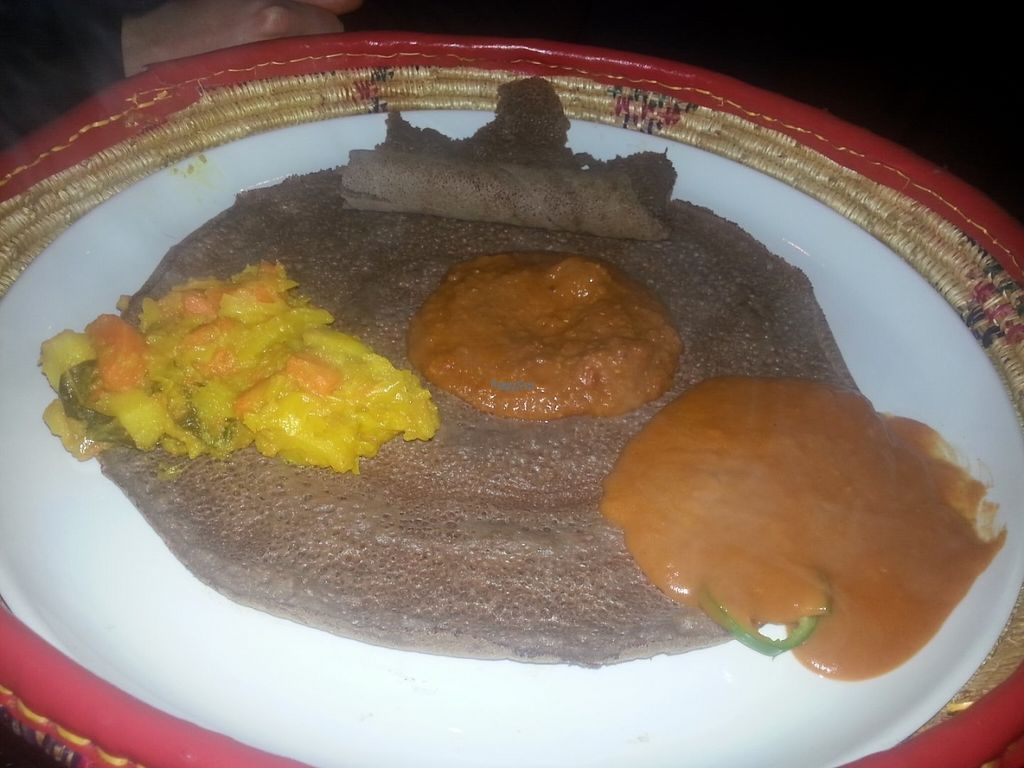 "Photo of Saba's Ethiopian Restaurant   by <a href=""/members/profile/KatieBatty"">KatieBatty</a> <br/>Ethiopian flat bread with three vegetarian dishes <br/> August 1, 2016  - <a href='/contact/abuse/image/63230/164047'>Report</a>"