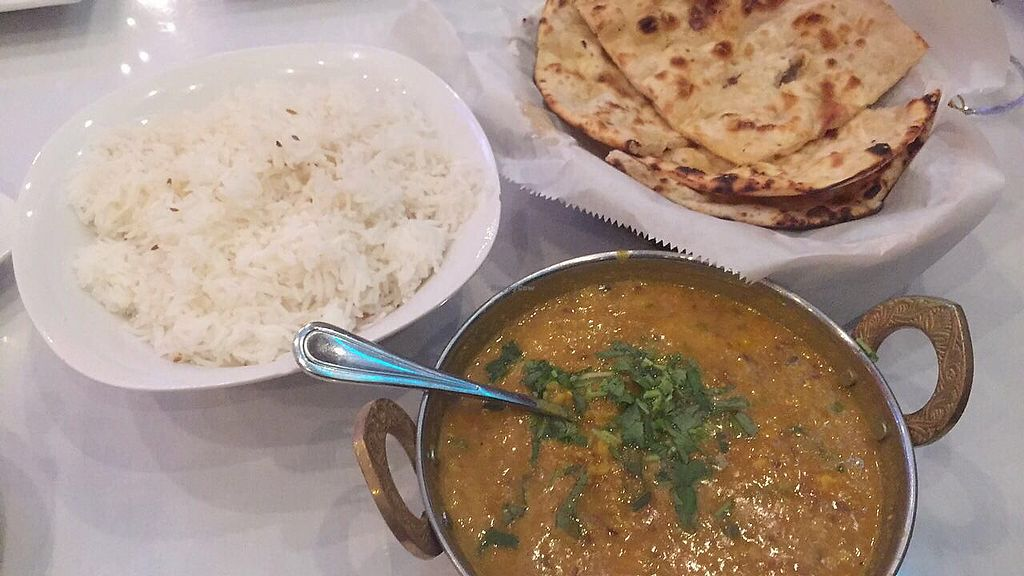 """Photo of Tandoor  by <a href=""""/members/profile/happycowgirl"""">happycowgirl</a> <br/>Dal Tadka (yellow lentils-vegan) with naan and rice <br/> September 6, 2017  - <a href='/contact/abuse/image/63376/301321'>Report</a>"""