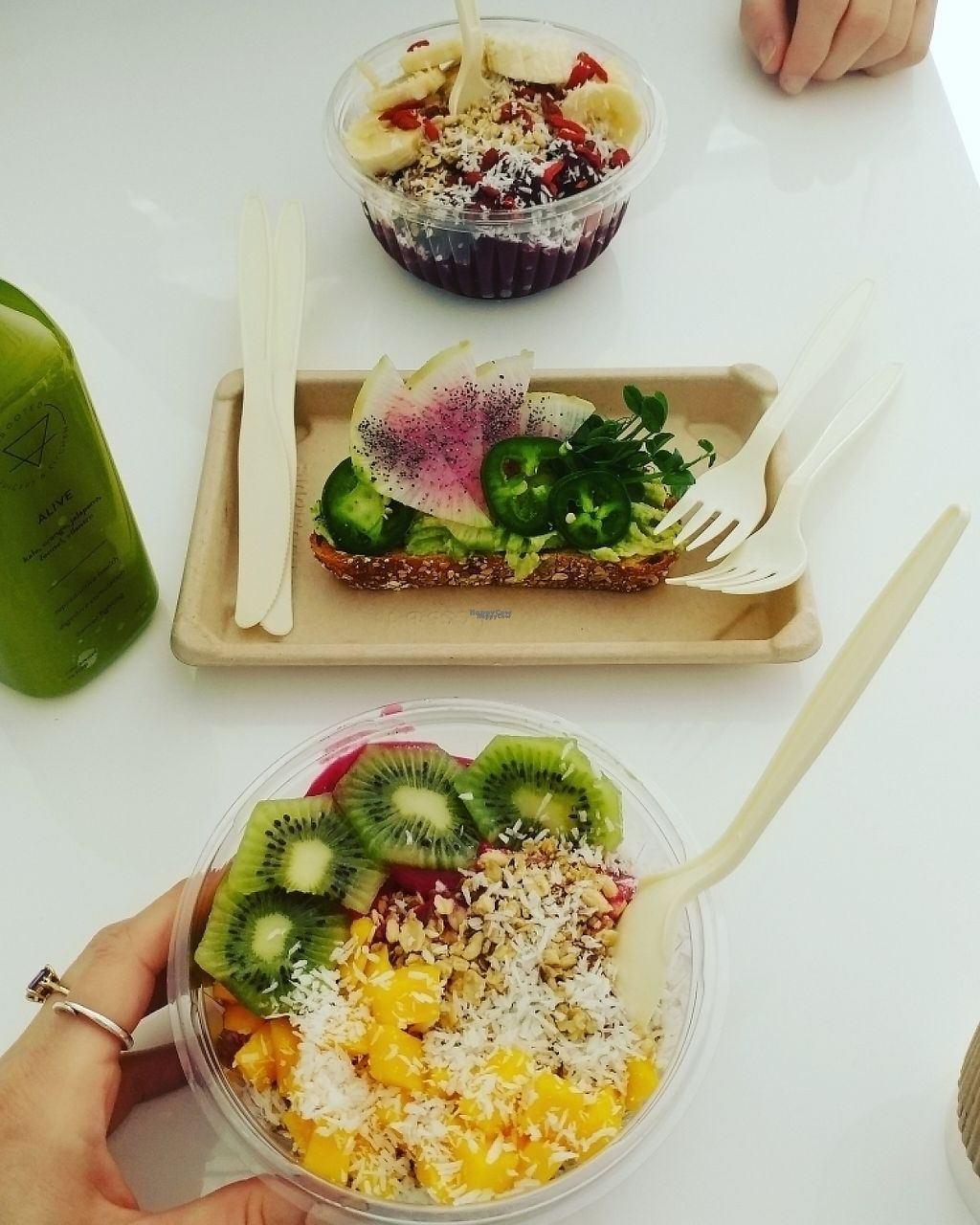 """Photo of Rooted Juicery and Kitchen  by <a href=""""/members/profile/KatBarry"""">KatBarry</a> <br/>Brunch of Smoothie Bowls and Avo Toast <br/> March 15, 2017  - <a href='/contact/abuse/image/63466/236627'>Report</a>"""