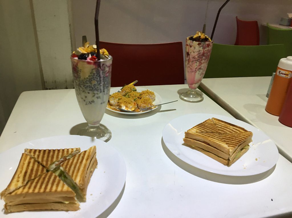 "Photo of Taste of Mumbai Haji Ali   by <a href=""/members/profile/Bobozmom"">Bobozmom</a> <br/>veg badji sandwich  and mixed fruit fahlooda <br/> April 29, 2017  - <a href='/contact/abuse/image/63578/253671'>Report</a>"
