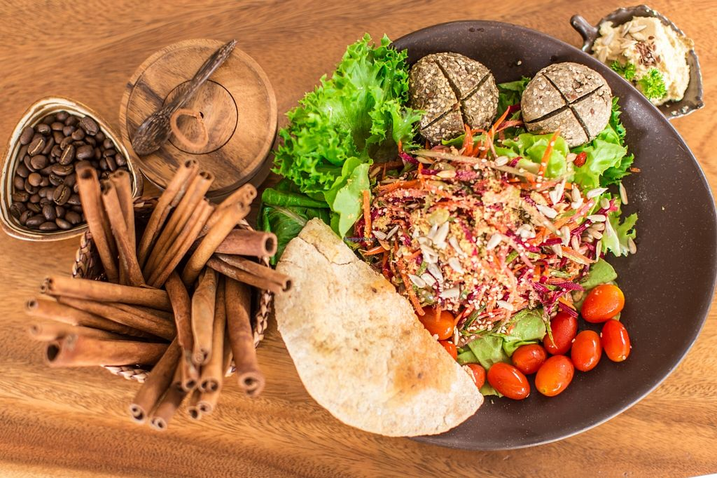 """Photo of Yogi Cafe  by <a href=""""/members/profile/yogi%20cafe"""">yogi cafe</a> <br/>Salad yogi with pita bread ,hummus, falafel mushroom  <br/> September 21, 2015  - <a href='/contact/abuse/image/63690/118694'>Report</a>"""