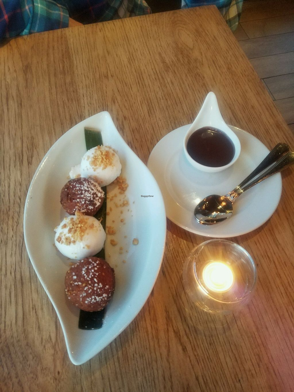 "Photo of Green Elephant Vegetarian Bistro & Bar  by <a href=""/members/profile/ehubert"">ehubert</a> <br/>Fried banana with coconut ice cream and chocolate drizzle  <br/> November 2, 2017  - <a href='/contact/abuse/image/64198/321285'>Report</a>"