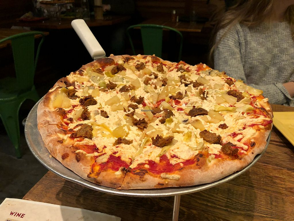 """Photo of Wild Tomato Pizza  by <a href=""""/members/profile/oskeewowwow"""">oskeewowwow</a> <br/>Vegan cheese, vegan sausage, artichoke hearts, pineapple. Normal crust contains honey  <br/> January 8, 2018  - <a href='/contact/abuse/image/64266/344467'>Report</a>"""