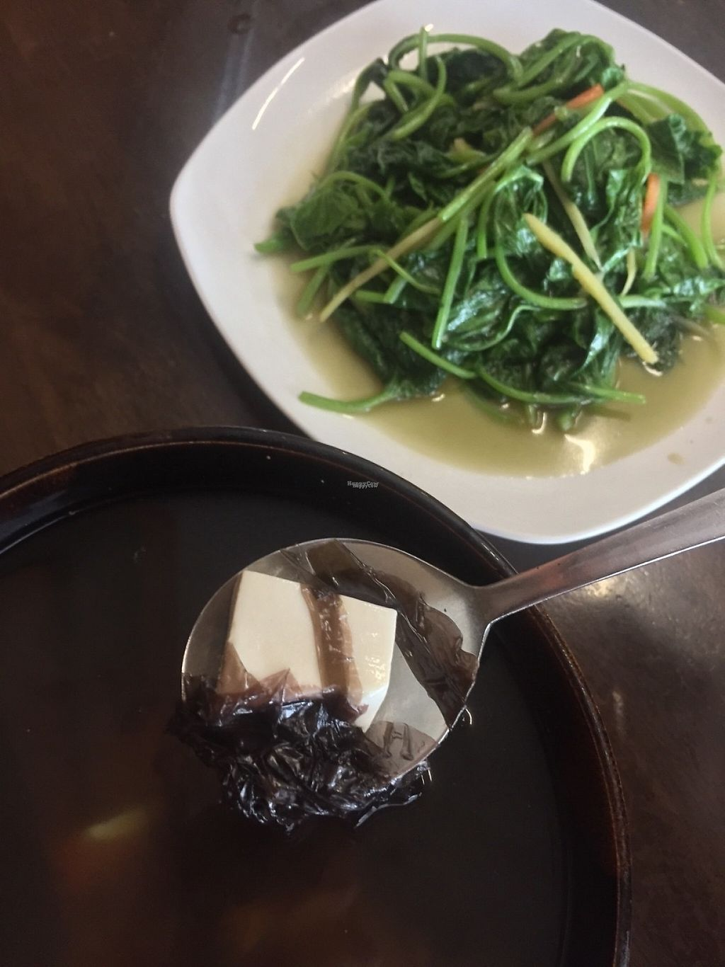 """Photo of Vegan House  by <a href=""""/members/profile/sarah_abdulm"""">sarah_abdulm</a> <br/>Seaweed tofu soup (not that great) and stir fried sweet potato leaves (my favourite local greens!)  <br/> February 26, 2017  - <a href='/contact/abuse/image/64308/230654'>Report</a>"""