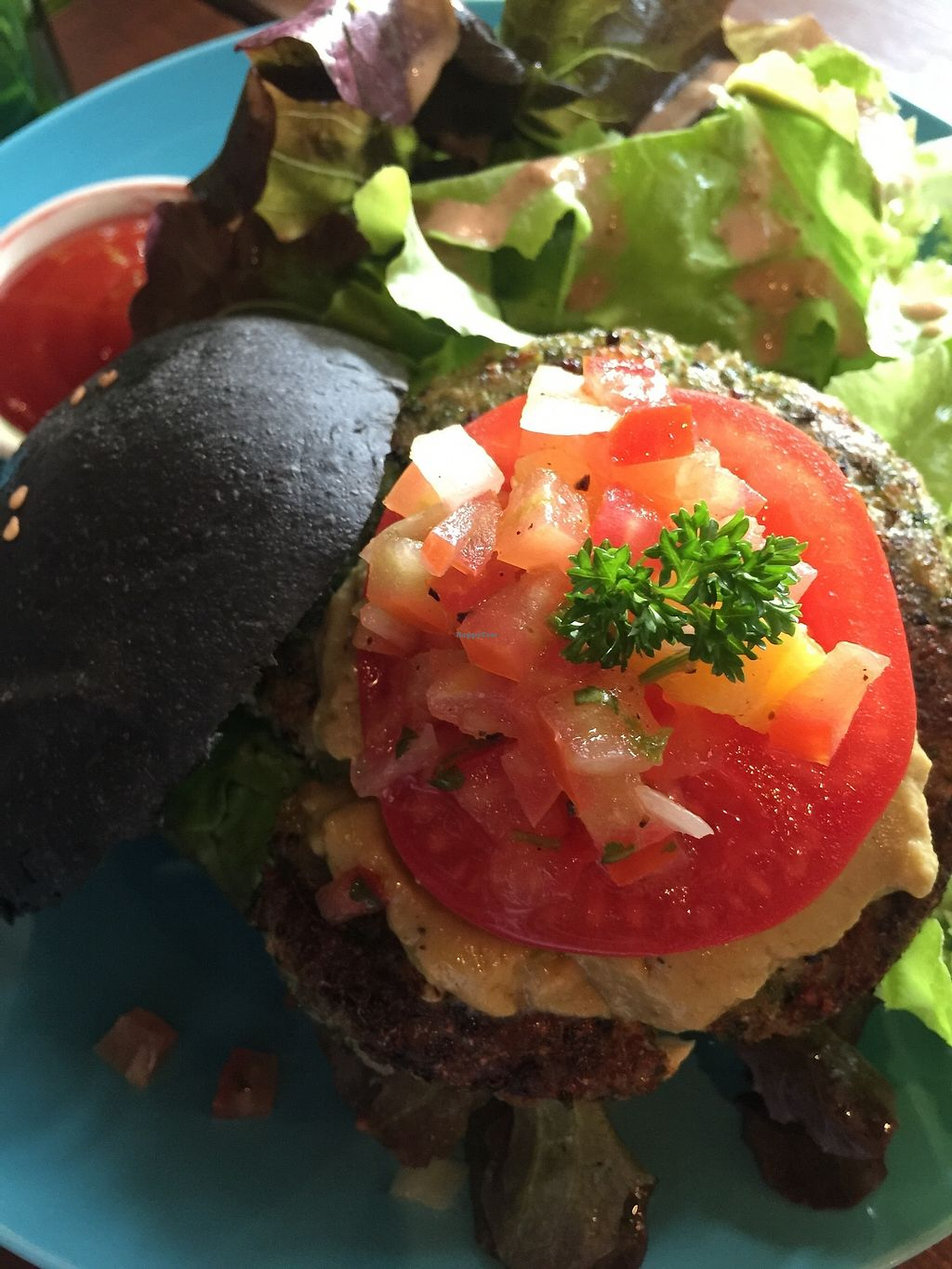"""Photo of Broccoli Revolution - Sukhumvit Rd  by <a href=""""/members/profile/JaqVeganWriter"""">JaqVeganWriter</a> <br/>Broccoli Charcoal Burger <br/> February 16, 2018  - <a href='/contact/abuse/image/64334/359953'>Report</a>"""