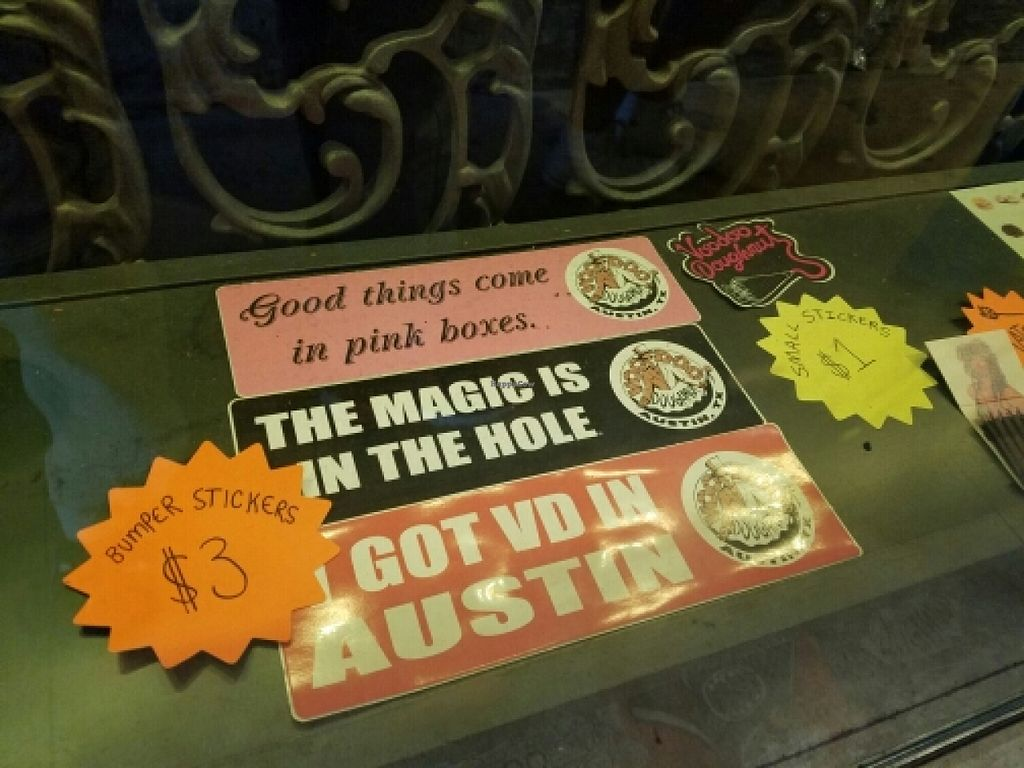"""Photo of Voodoo Doughnuts  by <a href=""""/members/profile/EverydayTastiness"""">EverydayTastiness</a> <br/>bumper stickers <br/> April 9, 2016  - <a href='/contact/abuse/image/64437/143698'>Report</a>"""