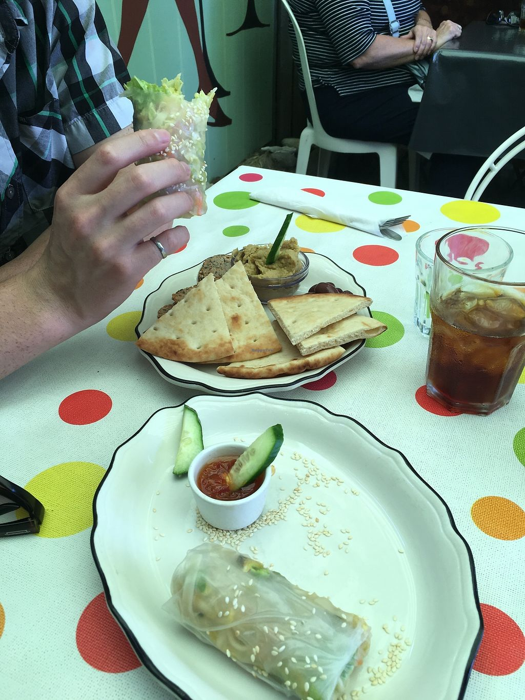 "Photo of Desert Rose Cafe  by <a href=""/members/profile/Cat_Mamma"">Cat_Mamma</a> <br/>The Quick Fix (hummus, olives, and flatbread) and Salad Spring Rolls. Both vegan! <br/> July 4, 2017  - <a href='/contact/abuse/image/64661/276513'>Report</a>"
