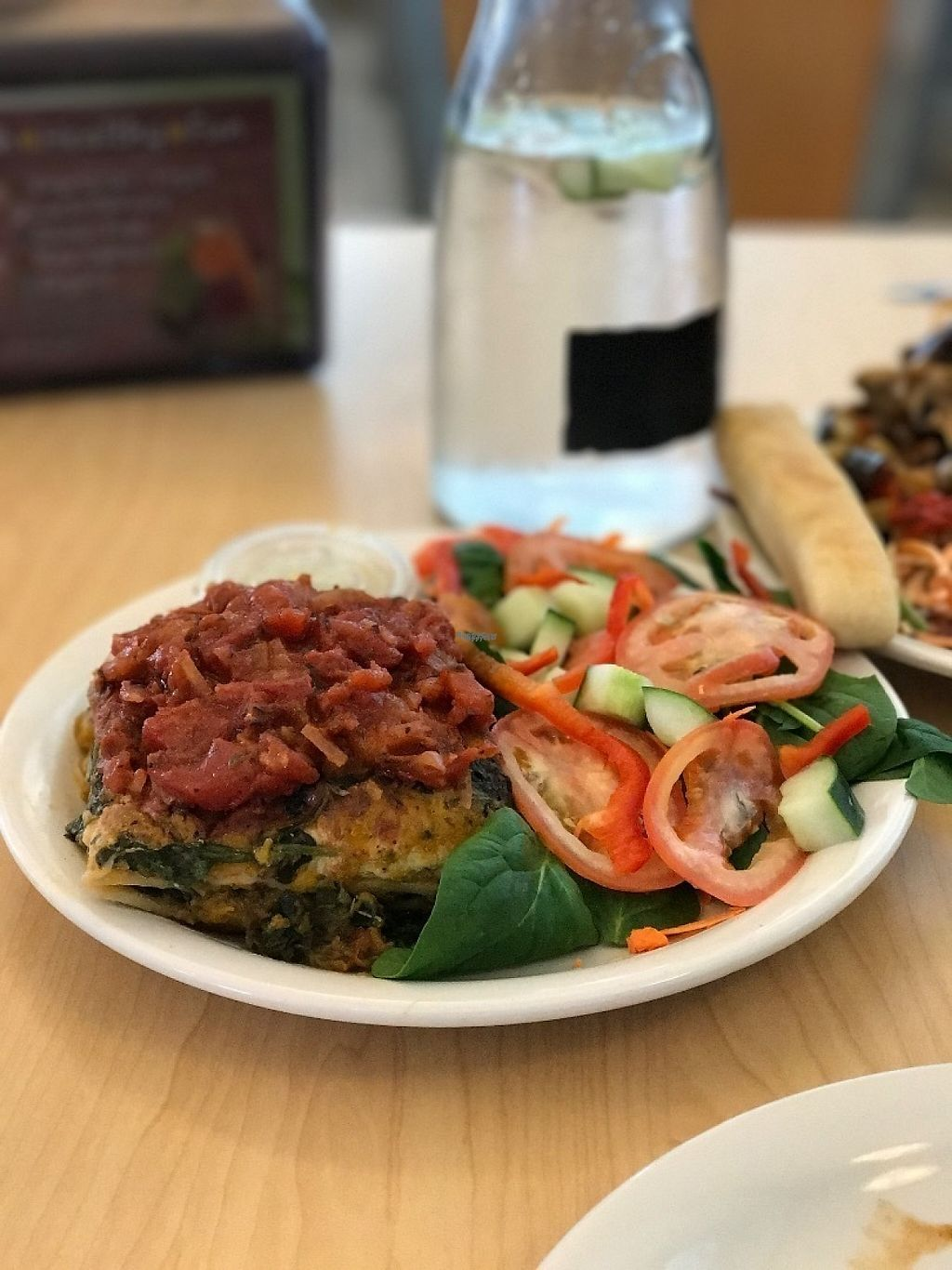 """Photo of Wild Rabbit Cafe and Health Bar  by <a href=""""/members/profile/DillonAbraham"""">DillonAbraham</a> <br/>Spinach Butternut Squash lasagna. Made with tofu ricotta and topped with fresh chunky marinara. Served with a salad (spinach, tomato, carrot, cucumber, bell pepper) and house dressing.  <br/> February 14, 2017  - <a href='/contact/abuse/image/64764/226392'>Report</a>"""