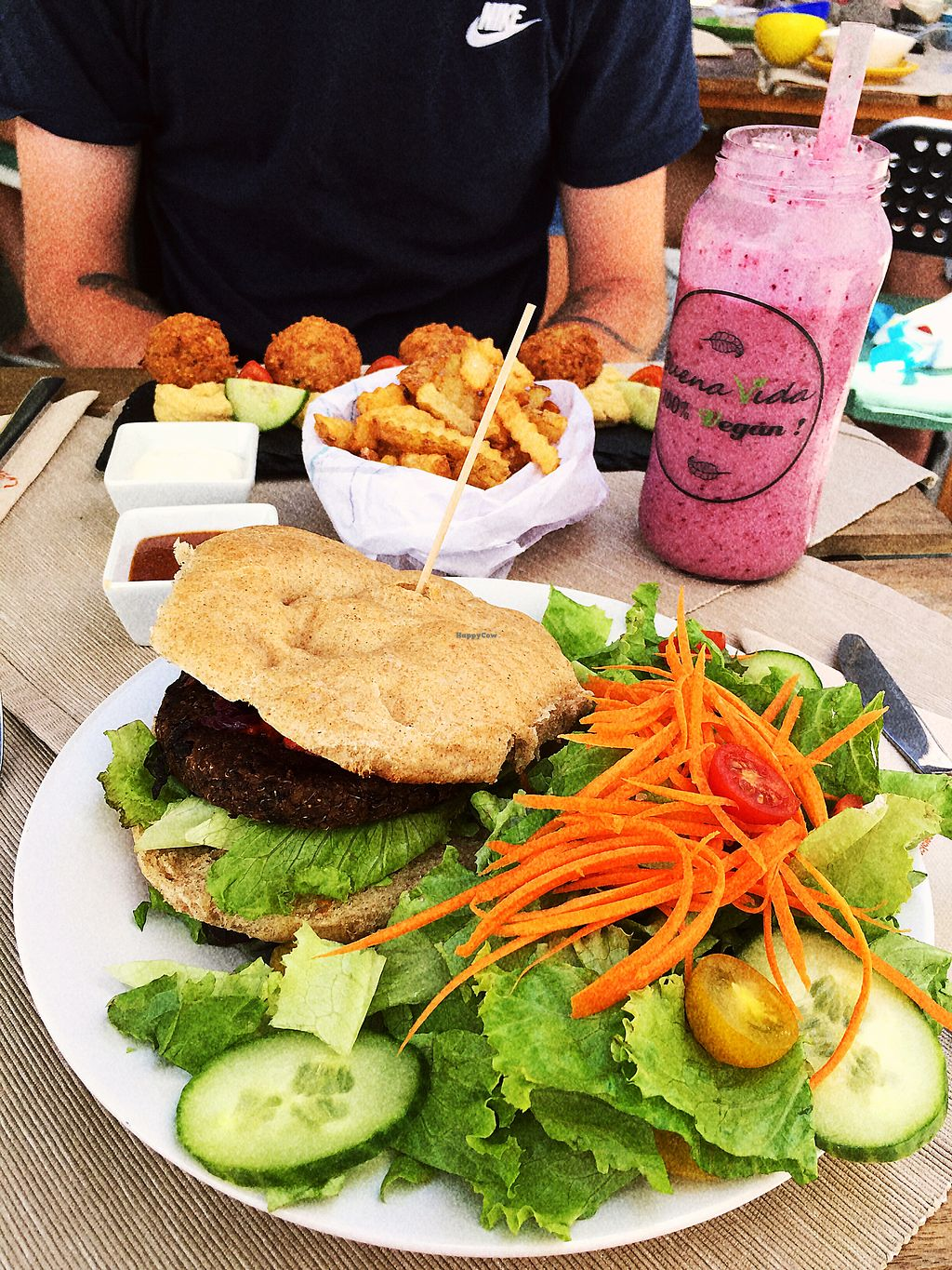"Photo of Buenavida Vegan  by <a href=""/members/profile/megmate"">megmate</a> <br/>quinoa burger with salad, falafels, chips and wild berry smoothie <br/> August 5, 2017  - <a href='/contact/abuse/image/64893/289195'>Report</a>"