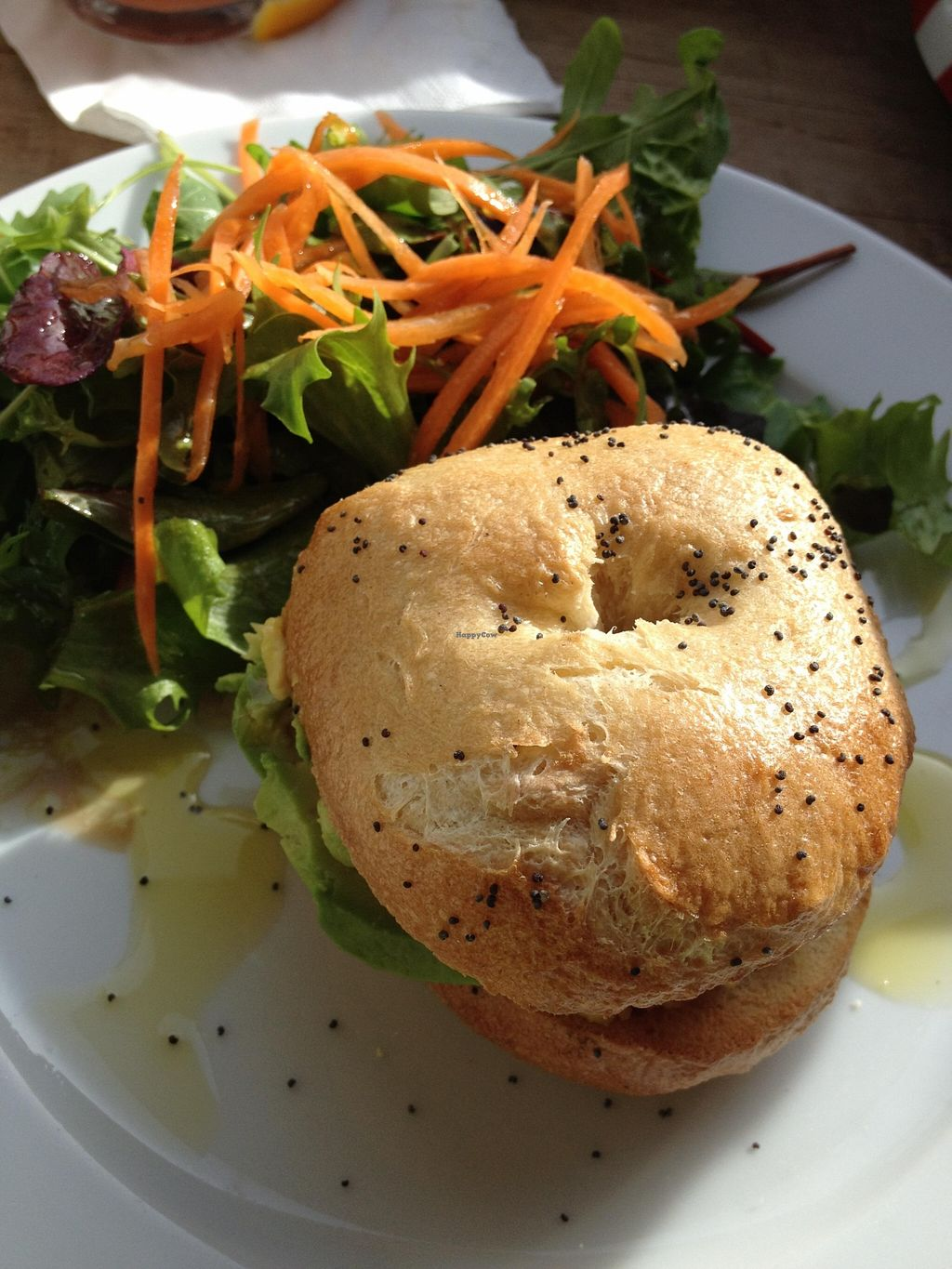 """Photo of Espresso Library  by <a href=""""/members/profile/chapstick"""">chapstick</a> <br/>Sunday brunch special - fresh, locally-baked bagel with red pepper hummus, avocado, sun-dried tomato; and delicious dressing on the side salad! <br/> October 28, 2015  - <a href='/contact/abuse/image/65013/122946'>Report</a>"""