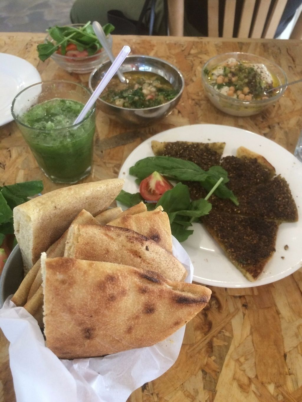 "Photo of Shams El Balad Cafe  by <a href=""/members/profile/strickvl"">strickvl</a> <br/>Za3tar bread, hummus, baba ghanoush and bread (and lemon & mint juice) <br/> August 20, 2016  - <a href='/contact/abuse/image/65293/170226'>Report</a>"