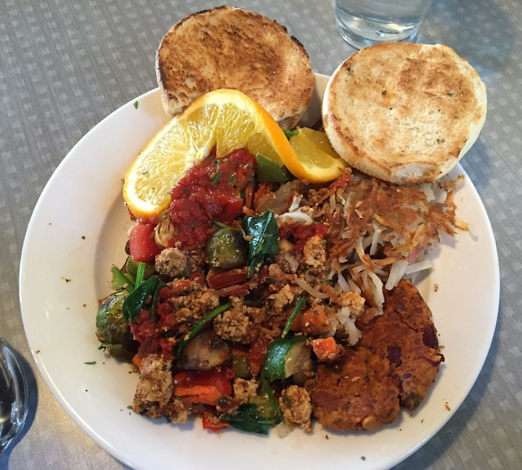 "Photo of Birdies Cafe  by <a href=""/members/profile/notameat"">notameat</a> <br/>This is the Tofu Hash Deluxe: Savory and delicious tofu and veggie hash served with choice of potatoes or beans and rice, and toast or English muffin.  I had also ordered a side of their house made vegan sausage which you can see on the same plate.  <br/> January 12, 2016  - <a href='/contact/abuse/image/65462/218755'>Report</a>"
