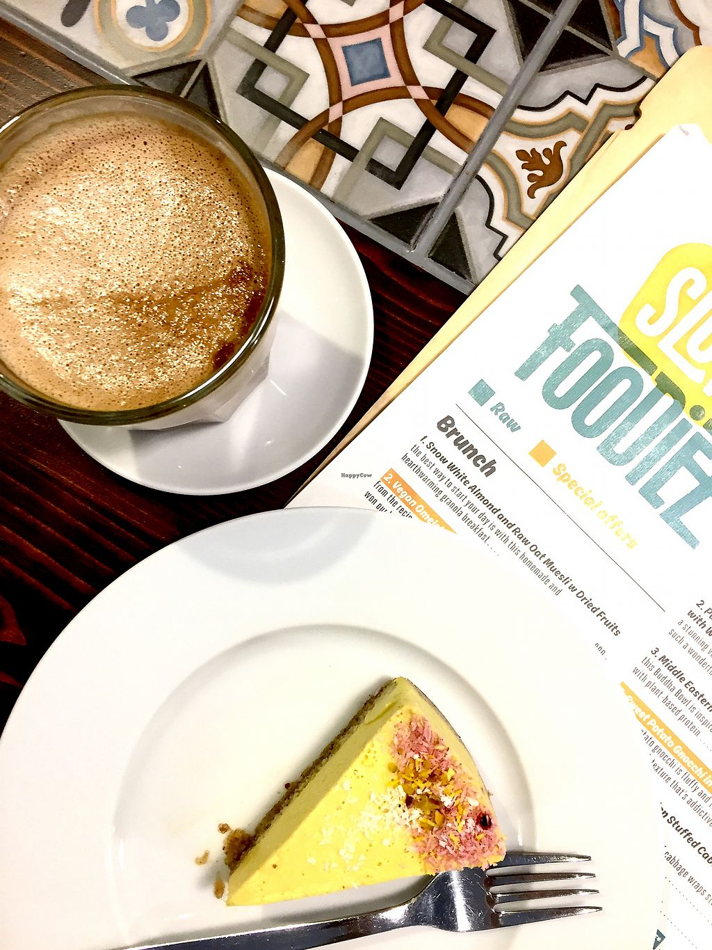 """Photo of Slow Foodiez  by <a href=""""/members/profile/KatjaValentinaKramp"""">KatjaValentinaKramp</a> <br/>Raw orange / ginger cake and oat milk latte  <br/> January 30, 2018  - <a href='/contact/abuse/image/65490/352814'>Report</a>"""