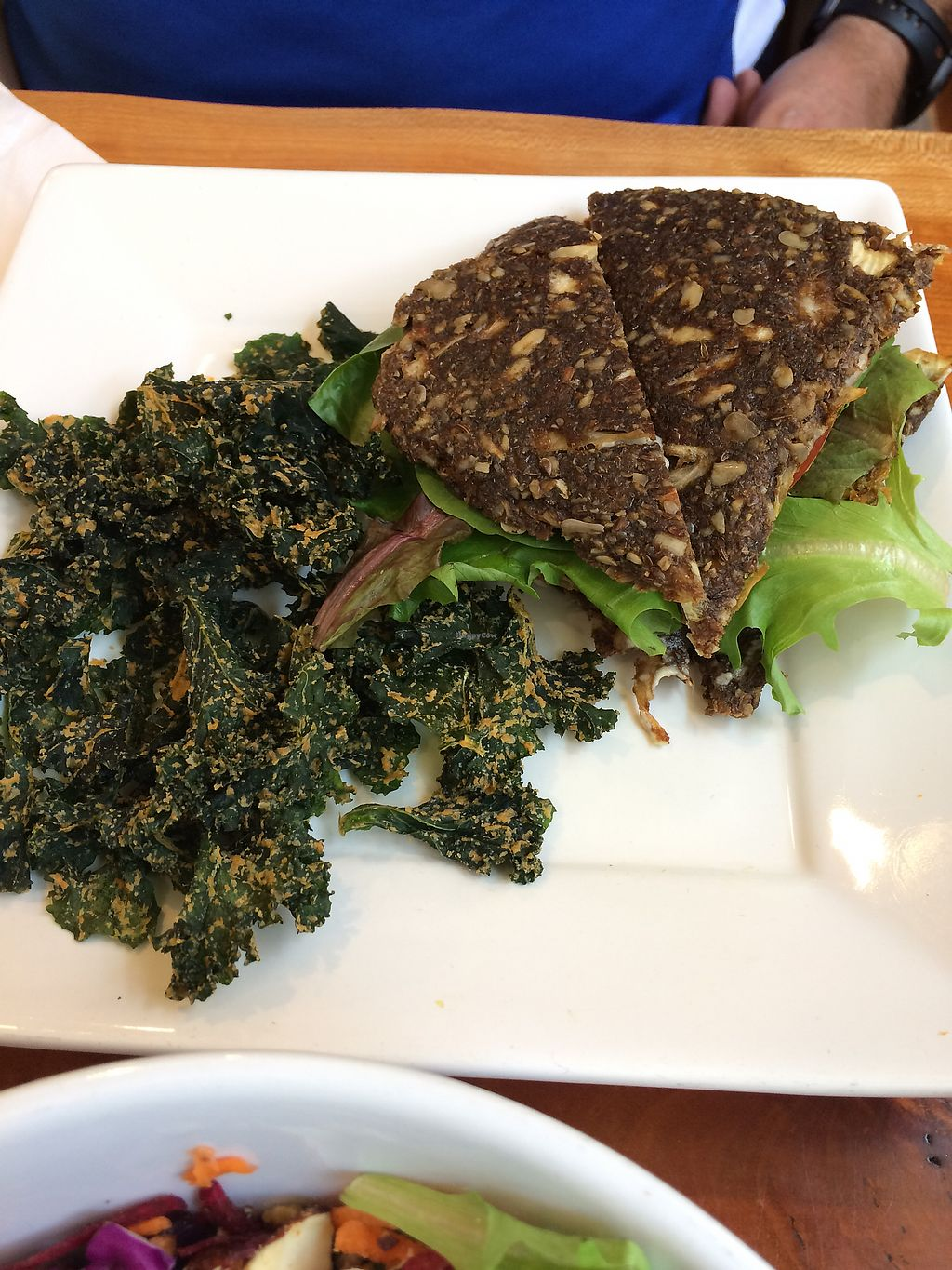 """Photo of Right Path Organic Cafe  by <a href=""""/members/profile/Indyk"""">Indyk</a> <br/>Sun burger on onion bread with kale chips <br/> July 22, 2017  - <a href='/contact/abuse/image/65514/283266'>Report</a>"""