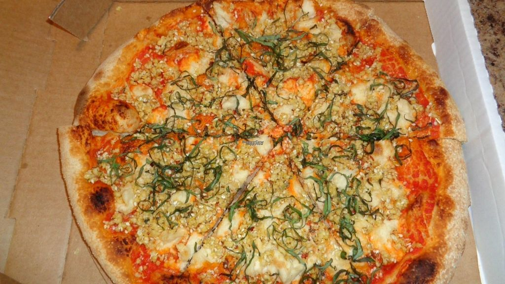 """Photo of Crumb & Spigot  by <a href=""""/members/profile/GeaugaVegan"""">GeaugaVegan</a> <br/>Vegan marinara pizza takeout with cashew mozzarella and pine nut parmesan. Excellent!  <br/> August 24, 2016  - <a href='/contact/abuse/image/65576/171294'>Report</a>"""