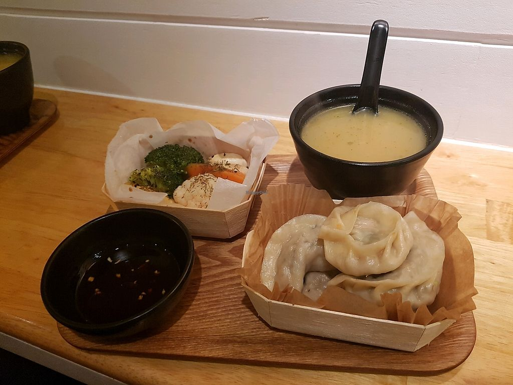 """Photo of Mo Mo - Ixelles  by <a href=""""/members/profile/pazinjanka"""">pazinjanka</a> <br/>Vegetables, dumplings, soup and sauce <br/> February 3, 2018  - <a href='/contact/abuse/image/65730/354572'>Report</a>"""