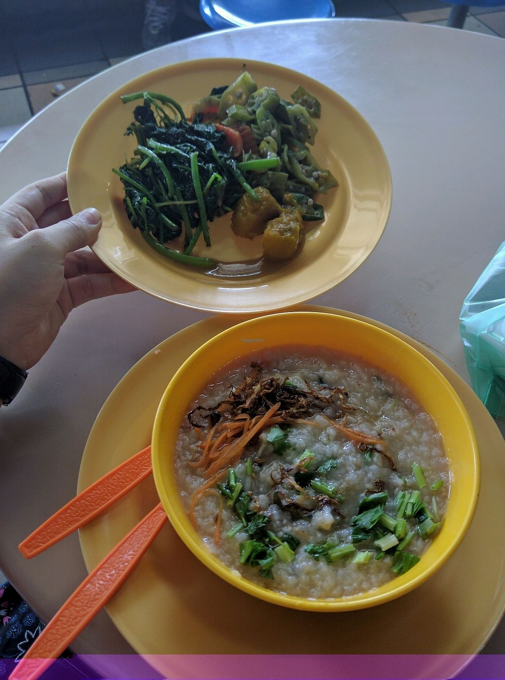 """Photo of Kompleks Sri Selera Bayan Baru - Vegetarian Stall  by <a href=""""/members/profile/Summer_Tan"""">Summer_Tan</a> <br/>Porridge (Monday's Special) and a plate with some dishes from the economy rice buffet (pumpkin, okra etc.) A good Hokkien style porridge, that is vegetarian! Rare find, and very tasty! <br/> February 2, 2018  - <a href='/contact/abuse/image/65929/354157'>Report</a>"""