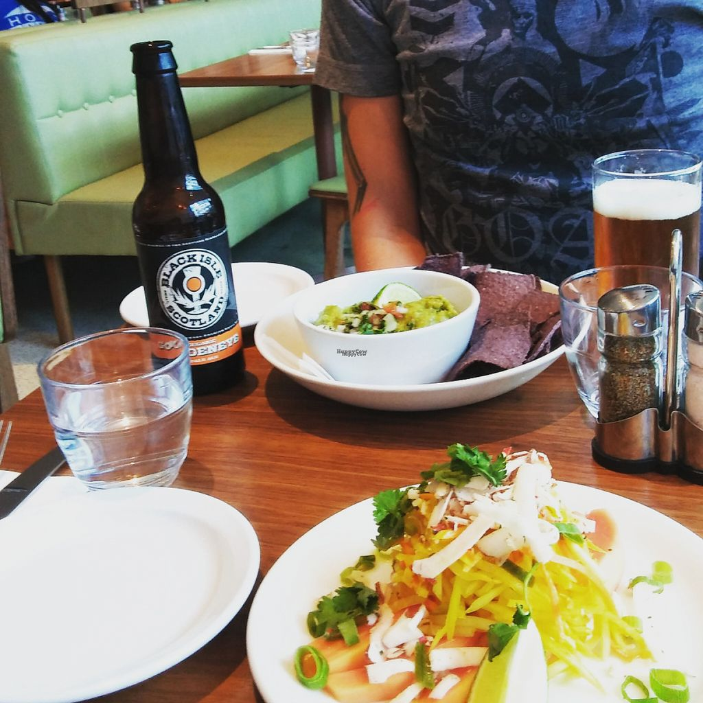"Photo of Mildred's  by <a href=""/members/profile/estelabay"">estelabay</a> <br/>Super spicy ?coconut papaya chili lime raw vegan salad, guacamole with blue corn chips and this Goldeneye Pale Ale for him <br/> October 29, 2016  - <a href='/contact/abuse/image/66389/185204'>Report</a>"