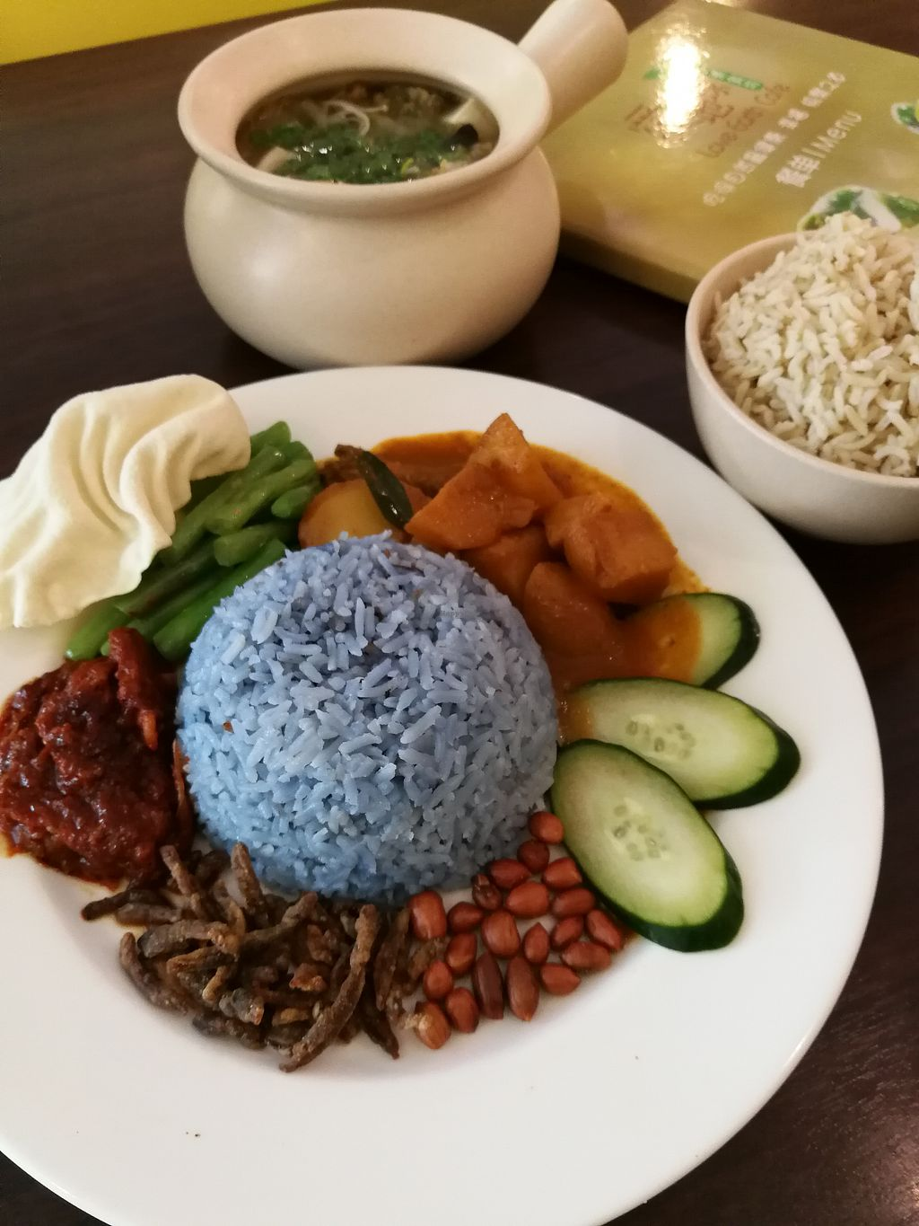 """Photo of Love Earth Cafe  by <a href=""""/members/profile/RawChefYin"""">RawChefYin</a> <br/>Nasi Lemak. Note the curry is not vegan as they mock meat has eggs in them. They gave us potatoes instead but after I finished my meal I found out they didn't cook the potatoes separately. I guess my chat with them got lost in translation... Perhaps I can ask for more vegetables next time or ask to cook one separately? <br/> April 24, 2018  - <a href='/contact/abuse/image/66553/390314'>Report</a>"""