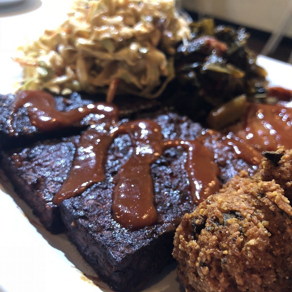 """Photo of Homegrown Smoker  by <a href=""""/members/profile/mcsnv"""">mcsnv</a> <br/>Combo Plate (Tempeh Ribs, H'yam) w/ Chipotle Slaw and Stewed Greens <br/> October 7, 2017  - <a href='/contact/abuse/image/66879/312811'>Report</a>"""