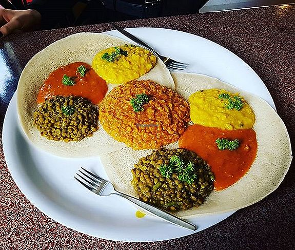 """Photo of Adulis  by <a href=""""/members/profile/Nadia123"""">Nadia123</a> <br/>Vegan platter for two on injera.  <br/> January 12, 2018  - <a href='/contact/abuse/image/67044/345726'>Report</a>"""