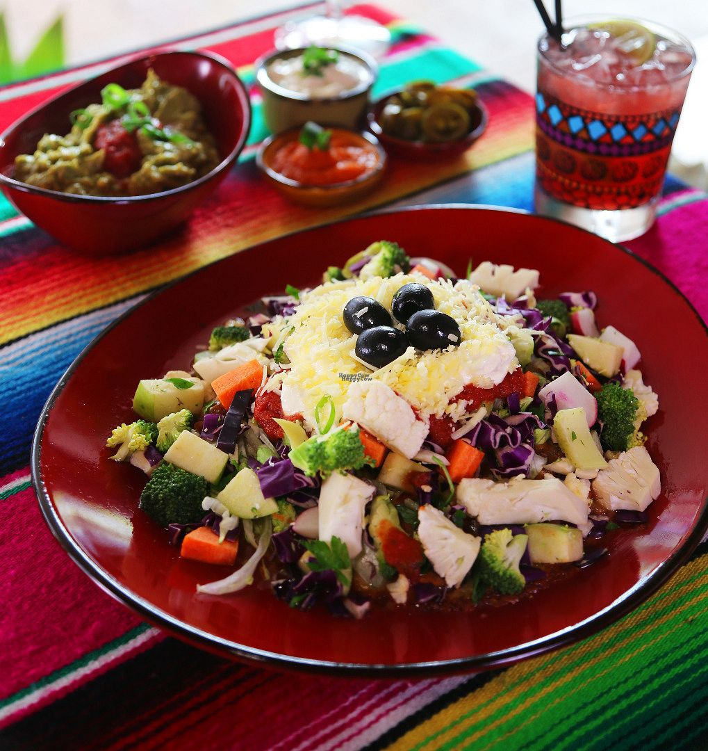 """Photo of Montezuma's  by <a href=""""/members/profile/MrMontezumas"""">MrMontezumas</a> <br/>Montezuma's Delight Vegan - A corn tortilla smothered with frijoles, vegan cheese, heaped with our diced vegetable salad, ranchero sauce, vegan sour cream, topped with sweet black olives & served with Spanish rice <br/> September 14, 2016  - <a href='/contact/abuse/image/67052/175743'>Report</a>"""