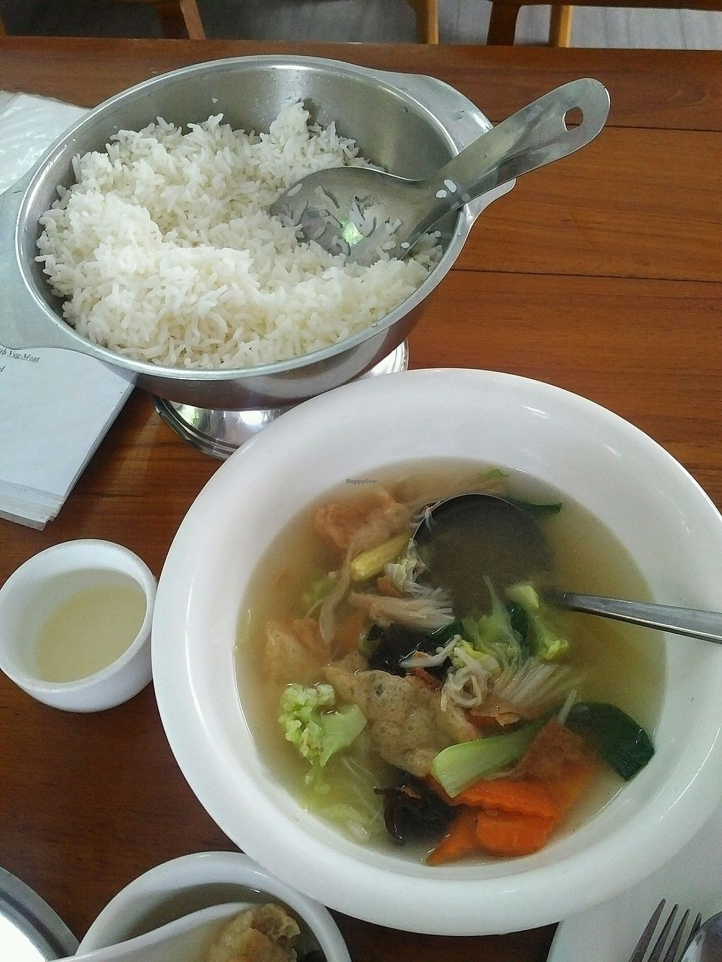 """Photo of Lanmadaw Vegetarian Restaurant  by <a href=""""/members/profile/CharbelKhoury"""">CharbelKhoury</a> <br/>vegetables soup and a pot of steamed rice  <br/> October 20, 2017  - <a href='/contact/abuse/image/67062/316849'>Report</a>"""