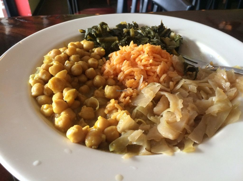 "Photo of Island Krave  by <a href=""/members/profile/LauraFlowers"">LauraFlowers</a> <br/>Large chickpea curry with greens, cabbage and yellow rice.  <br/> December 16, 2015  - <a href='/contact/abuse/image/67117/128699'>Report</a>"