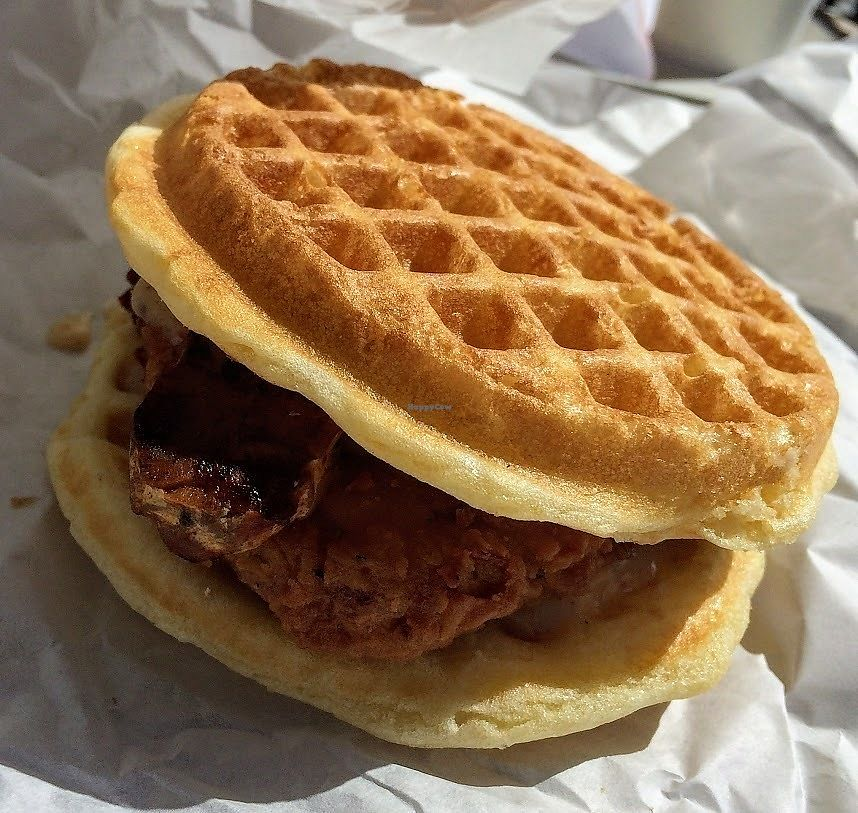 """Photo of Plant Power Fast Food  by <a href=""""/members/profile/fullbellyhappyheart"""">fullbellyhappyheart</a> <br/>Chicken 'n' Waffle Sandwich with maple bacon syrup. Indulgent and delicious <br/> June 20, 2017  - <a href='/contact/abuse/image/67395/271217'>Report</a>"""