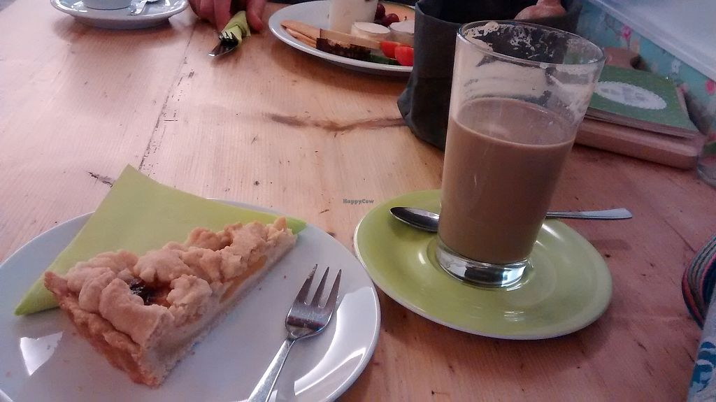 """Photo of Cafe Glucklich   by <a href=""""/members/profile/SaraC."""">SaraC.</a> <br/>Apricot cake, Power Chai and vegan breakfast in the background <br/> February 12, 2018  - <a href='/contact/abuse/image/67568/358293'>Report</a>"""