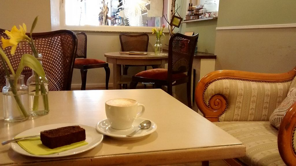 """Photo of Cafe Glucklich   by <a href=""""/members/profile/SaraC."""">SaraC.</a> <br/>Soj cappuccino and chocolate nuts cake <br/> February 12, 2018  - <a href='/contact/abuse/image/67568/358294'>Report</a>"""