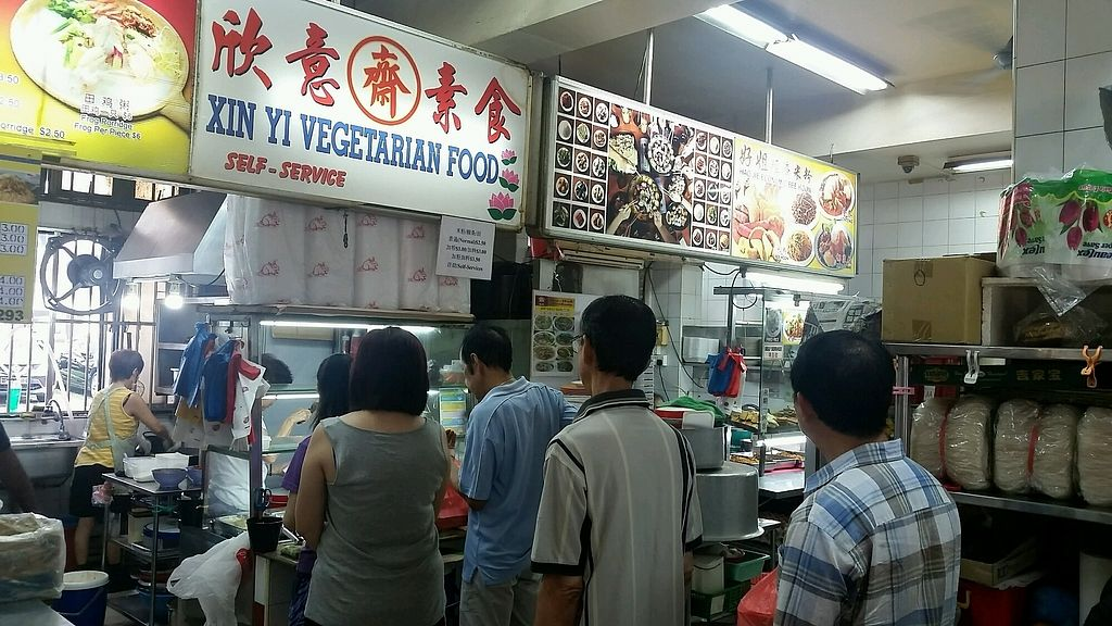 """Photo of Xin Yi Vegetarian Food  by <a href=""""/members/profile/JimmySeah"""">JimmySeah</a> <br/>queue in front of stall <br/> October 8, 2017  - <a href='/contact/abuse/image/67841/313101'>Report</a>"""