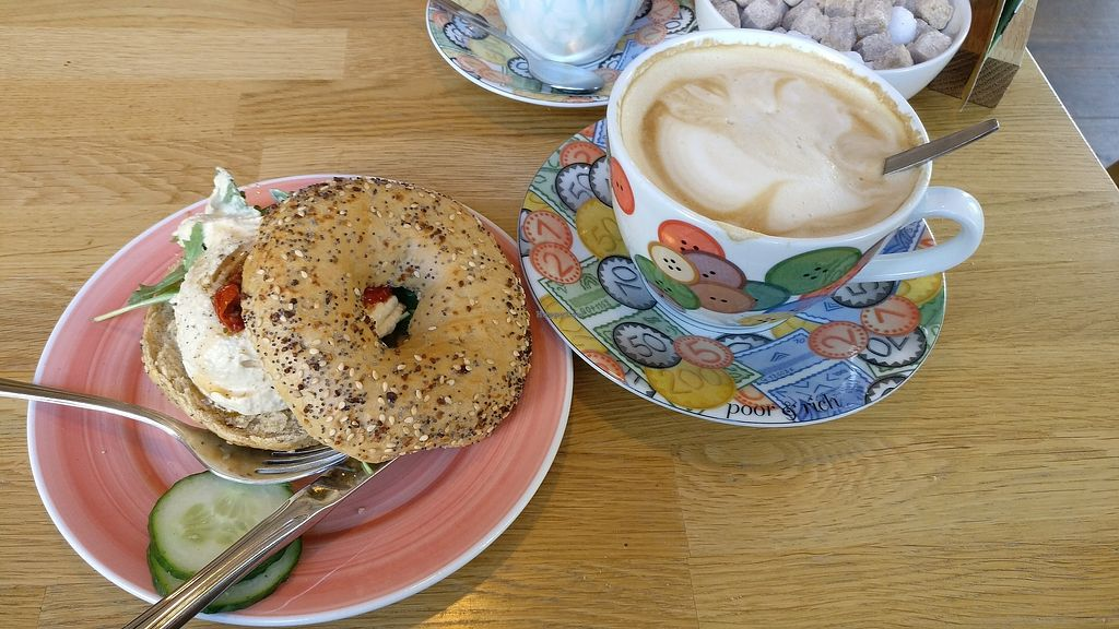 """Photo of Bagels & Beans  by <a href=""""/members/profile/NienkeFleur"""">NienkeFleur</a> <br/>""""everything sourdough"""" bagel with hummus, sun-dried tomatoes, and rocket lettuce, accompanied by a large Cappuccino <br/> January 2, 2018  - <a href='/contact/abuse/image/67869/342100'>Report</a>"""