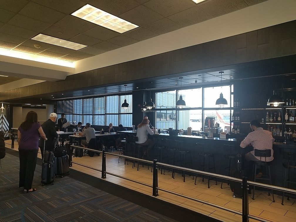 """Photo of &pizza - Airport  by <a href=""""/members/profile/mrd"""">mrd</a> <br/>Bar and seating area <br/> June 22, 2017  - <a href='/contact/abuse/image/67872/272094'>Report</a>"""