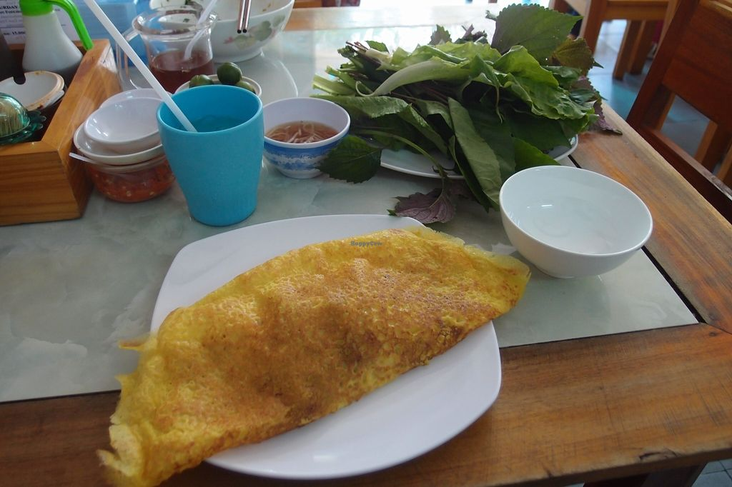 Photo of Bach Thao  by Vegreg <br/>Banh Xeo (pancake stuffed with veggies and mock meat). You cut one slice, roll it into a leaf of lettuce, add some mint/herbs, dip it into the sauce...yummy <br/> January 25, 2016  - <a href='/contact/abuse/image/67891/133630'>Report</a>