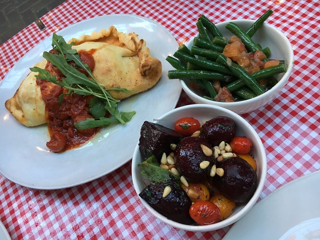 "Photo of Farelli's Trattoria  by <a href=""/members/profile/sousuneautrelentille"">sousuneautrelentille</a> <br/>Calzone (left) with side dishes on beets and green beans <br/> March 2, 2018  - <a href='/contact/abuse/image/68261/365703'>Report</a>"