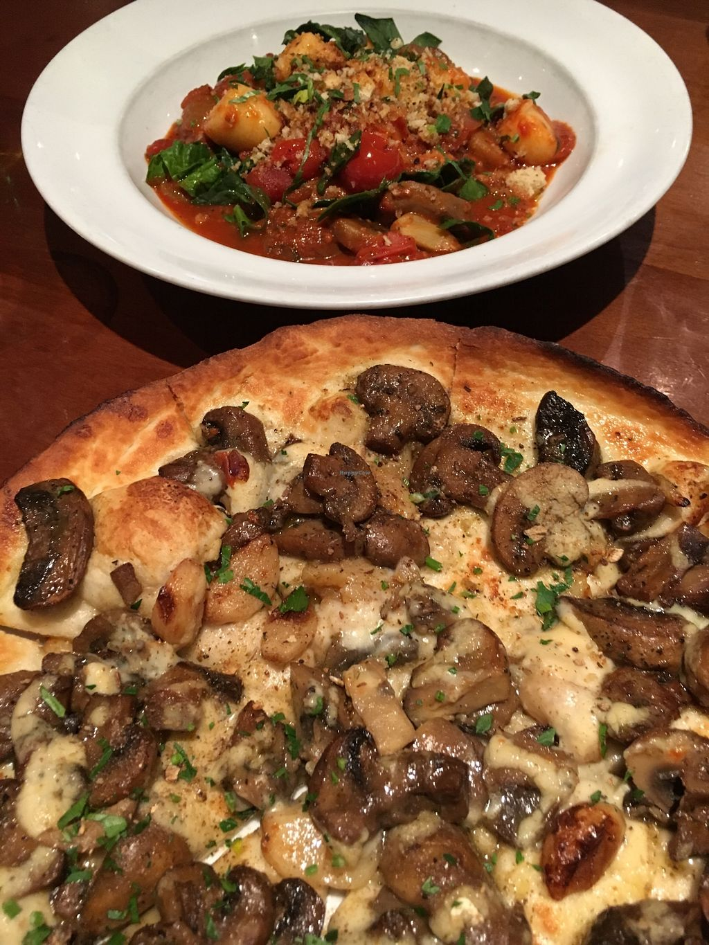 "Photo of Farelli's Trattoria  by <a href=""/members/profile/sousuneautrelentille"">sousuneautrelentille</a> <br/>Mushroom pizza (bottom) and gnocchi (top) <br/> March 2, 2018  - <a href='/contact/abuse/image/68261/365704'>Report</a>"