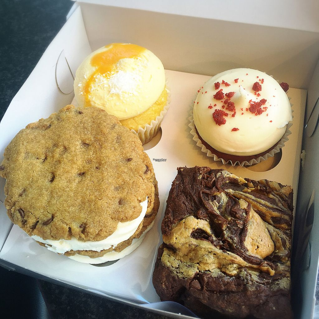 """Photo of Sugar Daddy's Bakery  by <a href=""""/members/profile/chloedaydream"""">chloedaydream</a> <br/>mango coconut cupcake, red velvet cupcake, cookie sandwich and peanut butter brownie  <br/> August 1, 2016  - <a href='/contact/abuse/image/68539/164344'>Report</a>"""