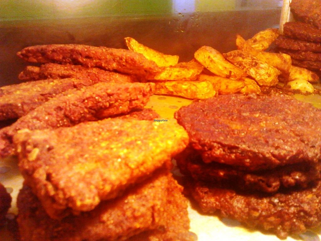 """Photo of Roots Reggae Vegetarian Cafe  by <a href=""""/members/profile/RootsReggae"""">RootsReggae</a> <br/>Vegan snacks - Lentil Fries/patties to the right, Seasoned potato wedges behind and Gluten slices to the left. Everything seasoned with natural herbs and spices and freshly made from scratch <br/> September 30, 2017  - <a href='/contact/abuse/image/68862/310187'>Report</a>"""
