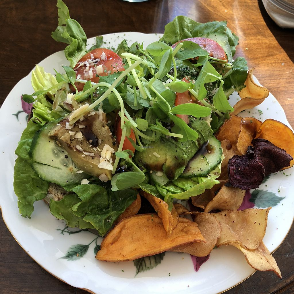 "Photo of Seaside Cake Parlour  by <a href=""/members/profile/TARAMCDONALD"">TARAMCDONALD</a> <br/>Sourdough open toasted sandwich with Avocado and salad.  Vegetable chips on the side.  <br/> April 19, 2018  - <a href='/contact/abuse/image/69071/388244'>Report</a>"