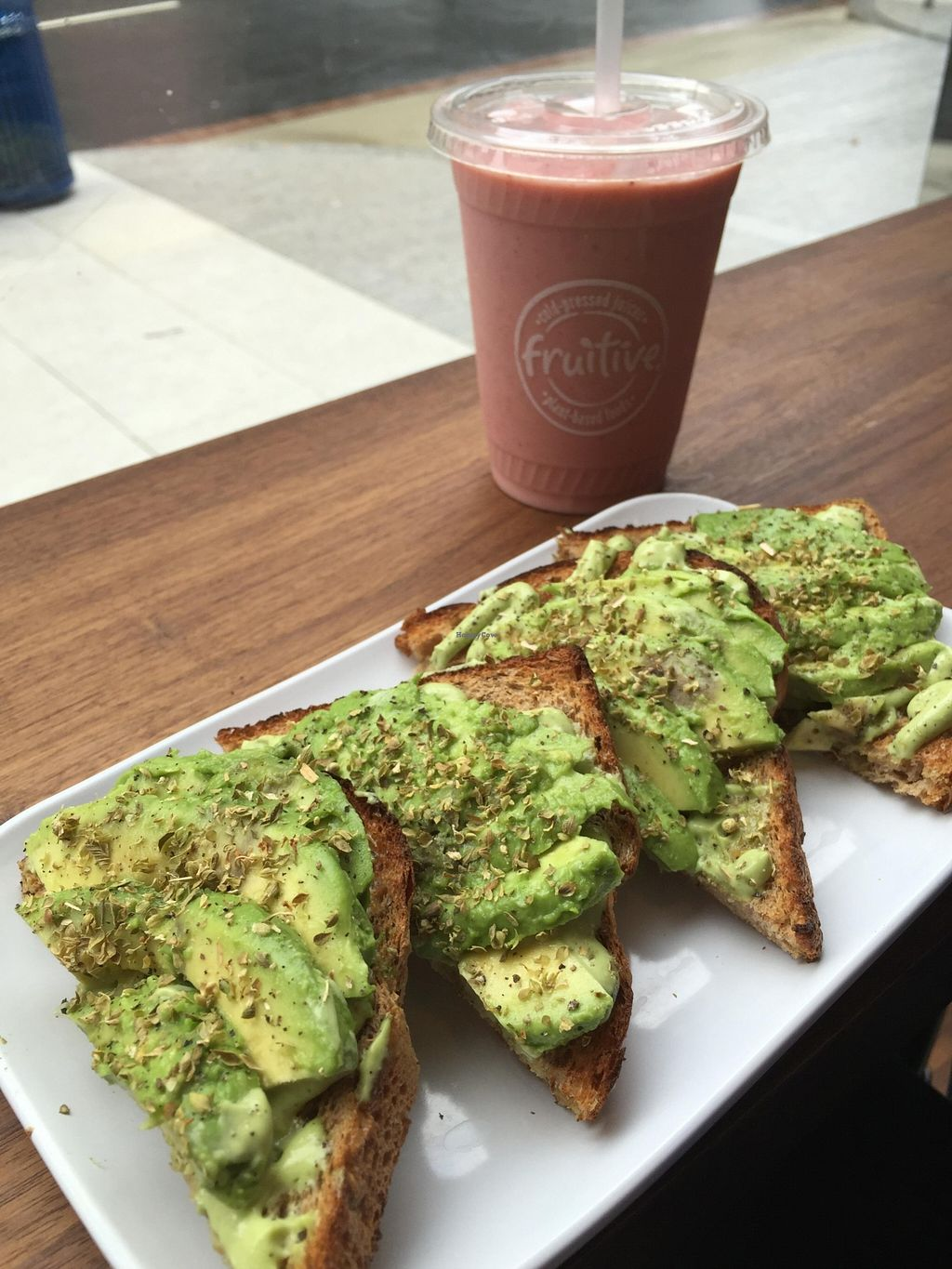 """Photo of Fruitive  by <a href=""""/members/profile/Karenk"""">Karenk</a> <br/>Avocado Toast with basil/avocado pesto - smoothie on the side <br/> April 4, 2016  - <a href='/contact/abuse/image/69107/142675'>Report</a>"""