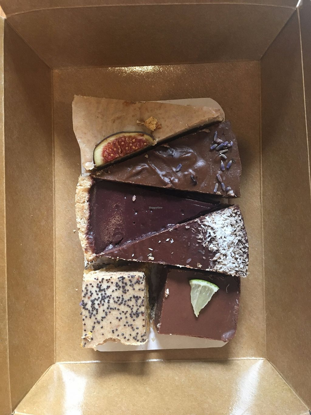 """Photo of Veggie Nyers  by <a href=""""/members/profile/tcsengusz"""">tcsengusz</a> <br/>Veggie Cake Selection Box - they have this event every other month, when you can buy a box of raw cakes of 6 for ca. 5 Euros. The September box included: lime brownie, figs and cashew, vanilla cashew with acai dressing, coconut, carob with lavender, apricot with poppy seeds.  <br/> September 20, 2017  - <a href='/contact/abuse/image/69131/306387'>Report</a>"""