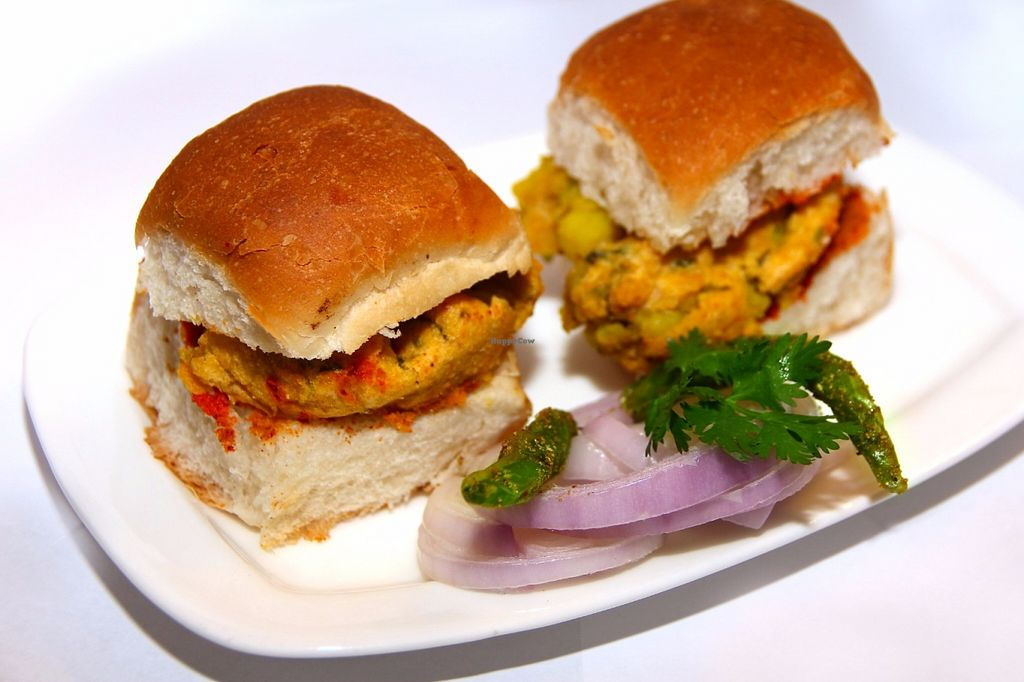 "Photo of Saattveek  by <a href=""/members/profile/saattveek"">saattveek</a> <br/>Vada Paav. A Mumbai street food made up of two parts; Vada - a mixture of Potato (boiled, mashed and tempered) coated with Chick pea flour and deep fried. Served in Dinner rolls with Garlic Chutney! <br/> June 12, 2016  - <a href='/contact/abuse/image/69252/153552'>Report</a>"